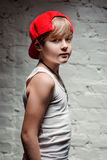 Portrait of cool young hip hop boy in red hat and red pants Royalty Free Stock Photography