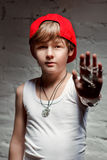 Portrait of cool young hip hop boy in red hat and red pants Stock Photos