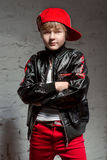 Portrait of cool young hip hop boy in white shirt and black leather jacket in the loft Stock Photography