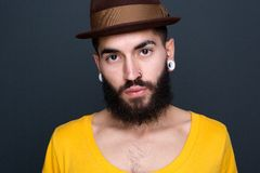 Portrait of a cool young man. Close up portrait of a cool young man with beard and piercing Royalty Free Stock Image