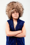 Portrait of cool young stylish boy in fur hat Royalty Free Stock Photo