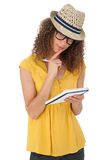 Portrait of a cool young woman writing in notepad Royalty Free Stock Photos