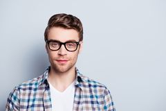 Portrait with copy space of smart, clever guy in glasses lookin royalty free stock image