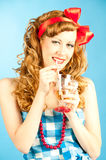Portrait coquettish Lovely redhead pin-up girl drinks. Royalty Free Stock Photography