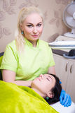 Portrait of cosmetician or dermatologist working in modern salon Stock Image