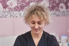Portrait of cosmetician. Pretty caucasian woman. Diploma in spa therapy stock image