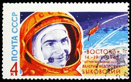 Portrait of cosmonaut V.F. Bykovsky and rocket, Second Group Spaceflight serie, circa 1963. MOSCOW, RUSSIA - MAY 25, 2019: Postage stamp printed in Soviet Union royalty free stock photography