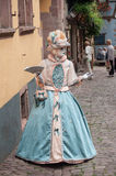 Portrait of Costumed woman with blue dress and fan at the Venetian Parade in Riquewihr in Alsace. RIQUEWIHR - France - 1 July 2017 - portrait of Costumed woman Stock Image