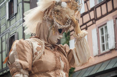 Portrait of Costumed woman at the Venetian Parade in Riquewihr in Alsace. RIQUEWIHR - France - 1 July 2017 - portrait of Costumed woman at the Venetian Parade in Stock Images
