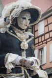 Portrait of Costumed woman at the Venetian Parade in Riquewihr in Alsace. RIQUEWIHR - France - 1 July 2017 - portrait of Costumed woman at the Venetian Parade in Royalty Free Stock Photography