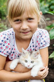 Portrait of a country girl with a kitten Stock Image
