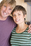 Portrait of couple arm in arm, smiling, close-up Royalty Free Stock Image