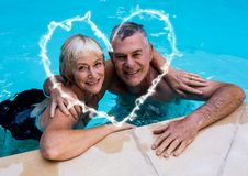 Portrait of couple with arm around in swimming pool Royalty Free Stock Photography