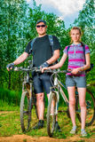 Portrait of a couple of athletes with bicycles Royalty Free Stock Photo