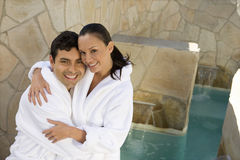 Portrait Of A Couple In Bathrobe Smiling Stock Images