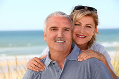 Portrait of a couple on the beach. Portrait of a smiling couple on the beach Stock Photo