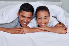 Portrait of couple bedroom. Portrait of young married couple on bed at home Royalty Free Stock Images