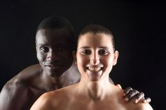 Portrait of a couple on black Stock Images