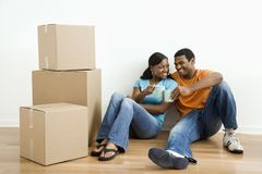Portrait of couple with boxes. Royalty Free Stock Image