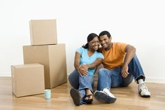 Portrait of couple with boxes. Stock Photo