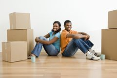 Portrait of couple with boxes. Stock Photography