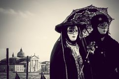 Couple of carnival black masks in Venice Royalty Free Stock Photography