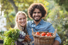 Portrait of couple carrying fresh vegetables Stock Image