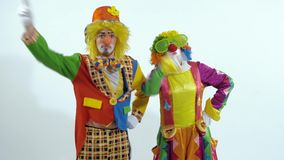 Portrait of a couple of circus clowns dancing in funny way stock footage