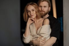 Portrait of couple, close to each other, hugging stock image