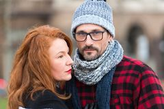Portrait of couple. Close up of man in glasses and woman profile. Portrait of brunette woman and guy in hat. stock photography