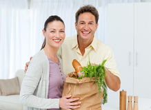 Portrait of a couple coming back from the market Royalty Free Stock Photography