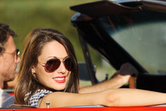 Portrait of a couple in a convertible car Stock Image