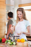 Portrait of a couple cooking Royalty Free Stock Images