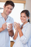 Portrait of a couple drinking coffee Stock Photo