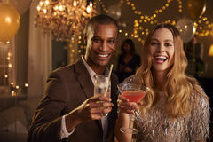 Portrait Of Couple With Drinks Enjoying Cocktail Party Royalty Free Stock Image