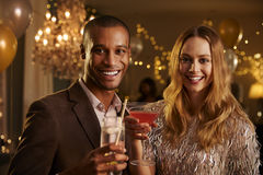 Portrait Of Couple With Drinks Enjoying Cocktail Party Stock Photography