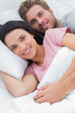 Portrait of a couple embracing in bed Royalty Free Stock Images
