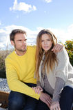 Portrait of couple embracing and enjoying golden autumn fall season - relax Royalty Free Stock Image