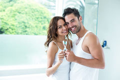Portrait of couple embracing while holding toothbrush Royalty Free Stock Photo