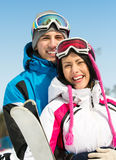 Portrait of couple embracing skiers Royalty Free Stock Images