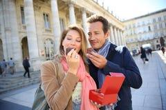 Portrait of couple enjoying eating pastries Stock Image