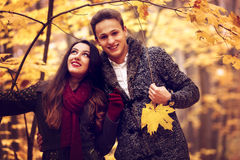 Portrait of couple enjoying golden autumn Stock Images