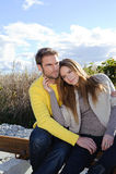 Portrait of couple enjoying golden autumn fall season - blue sky Stock Photos