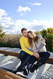Portrait of couple enjoying golden autumn fall season - blue sky Stock Photography