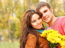 Portrait of couple enjoying golden autumn fall season Royalty Free Stock Photos