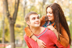 Portrait of couple enjoying golden autumn fall season Stock Photo