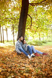 Portrait of couple enjoying golden autumn fall season Stock Photos