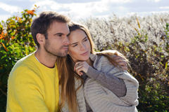 Portrait of couple enjoying golden autumn fall season - relaxing in autumn sun Royalty Free Stock Photo