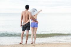Portrait Couple enjoying relaxing pointing at recreation. On tropical beach at Thailand Royalty Free Stock Images