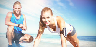 Portrait of couple exercising on sand Royalty Free Stock Image